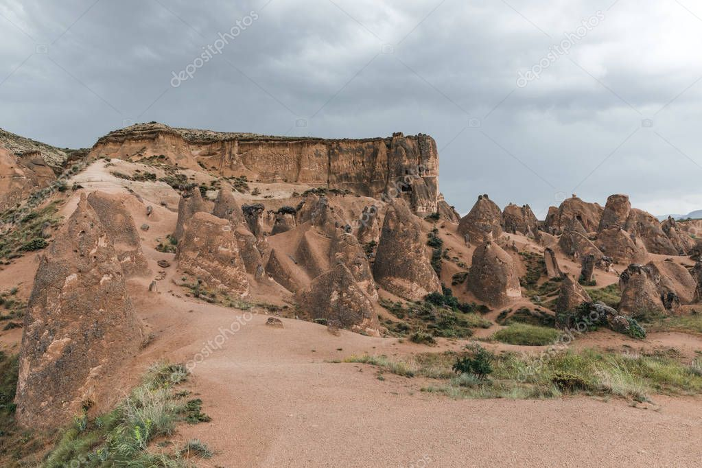 beautiful eroded rock formations at cloudy day, cappadocia, turkey