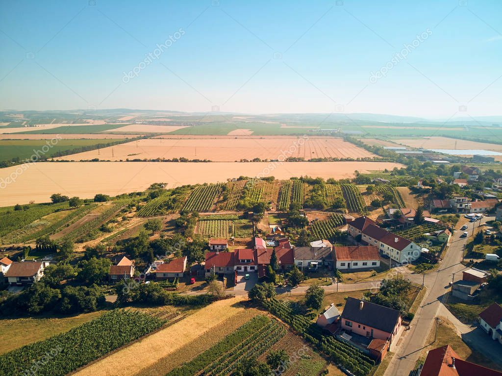 Aerial view of landscape with houses roofs and fields, Czech Republic