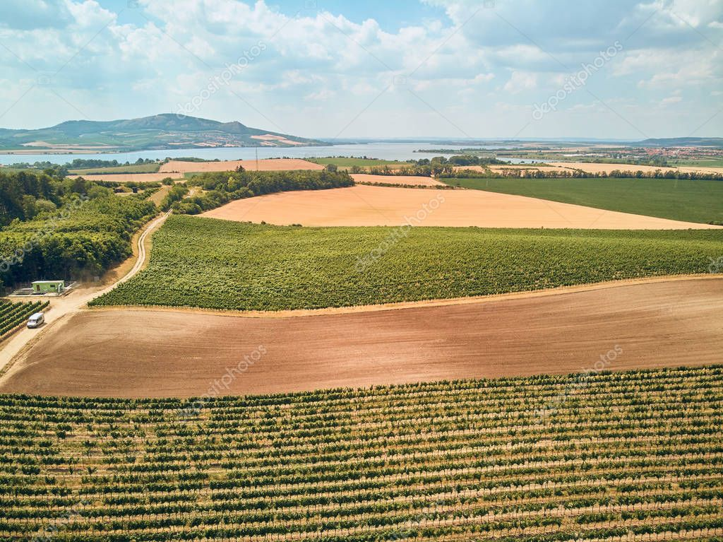 Aerial view of agricultural fields, river and mountains, Czech Republic