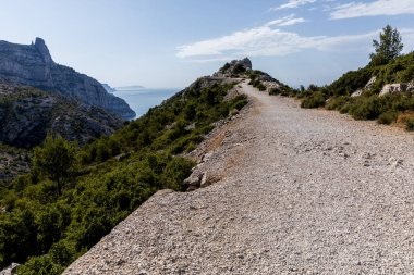 Rural road on mountain range, rocky mountains and scenic sea view in Calanques de Marseille (Massif des Calanques), provence, france stock vector