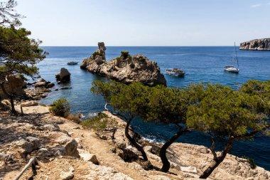 Beautiful cliffs, calm sea and boats in harbour, Calanques de Marseille (Massif des Calanques), provence, france stock vector