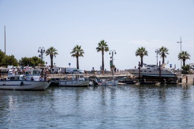 AVIGNON, FRANCE - JUNE 18, 2018: luxury yachts in port and beautiful palm trees on coast, Avignon, France