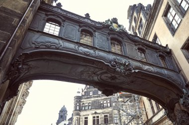 Low angle view of old black arch and dresden cathedral in Dresden, Germany