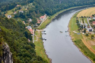 Aerial view of boats on elbe river, fields and small town in Bad Schandau, Germany stock vector