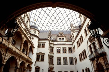 low angle view of old historical buildings and arch in Dresden, Germany