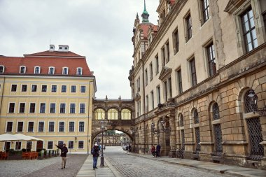 GERMANY, DRESDEN - 26 JUNE 2018: tourists taking photo and pointing on something on street