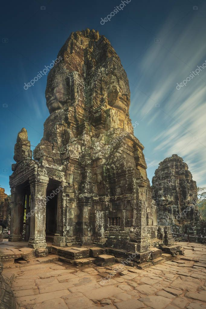 Day view of ancient temple Bayon Angkor with stone faces Siem Reap, Cambodia
