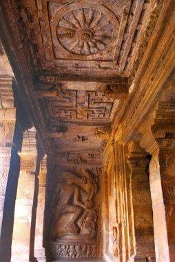 Cave 2 : The end walls of the outer verandah, left side. Badami Caves, Karnataka. Carved figure of Varaha, a boar, representation of Vishnu shown rescuing Bhudevi, a symbol of the earth, from the depths of the ocean. Ceiling showing a wheel with sixt