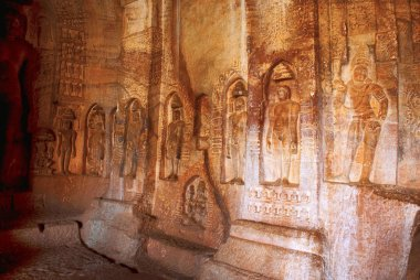 Cave 4 : Jaina Tirthankara images engraved on the inner pillars and walls. There are idols of Yakshas, Yakshis, Padmavati and other Tirthankaras. Badami caves, Badami, Karnataka, India.