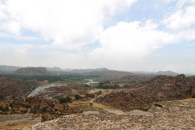 Arieal view of the chain of hills of Hampi from north side of Matanga Hill, Hampi, Karnataka, India. Sacred Center. The Anjeneya Hill is seen in the distance.