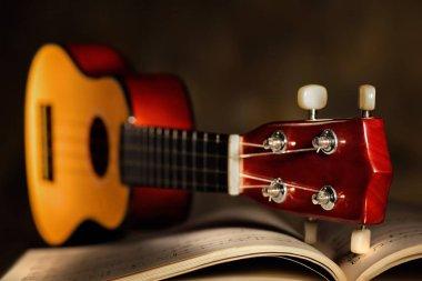 ukulele closeup with music score