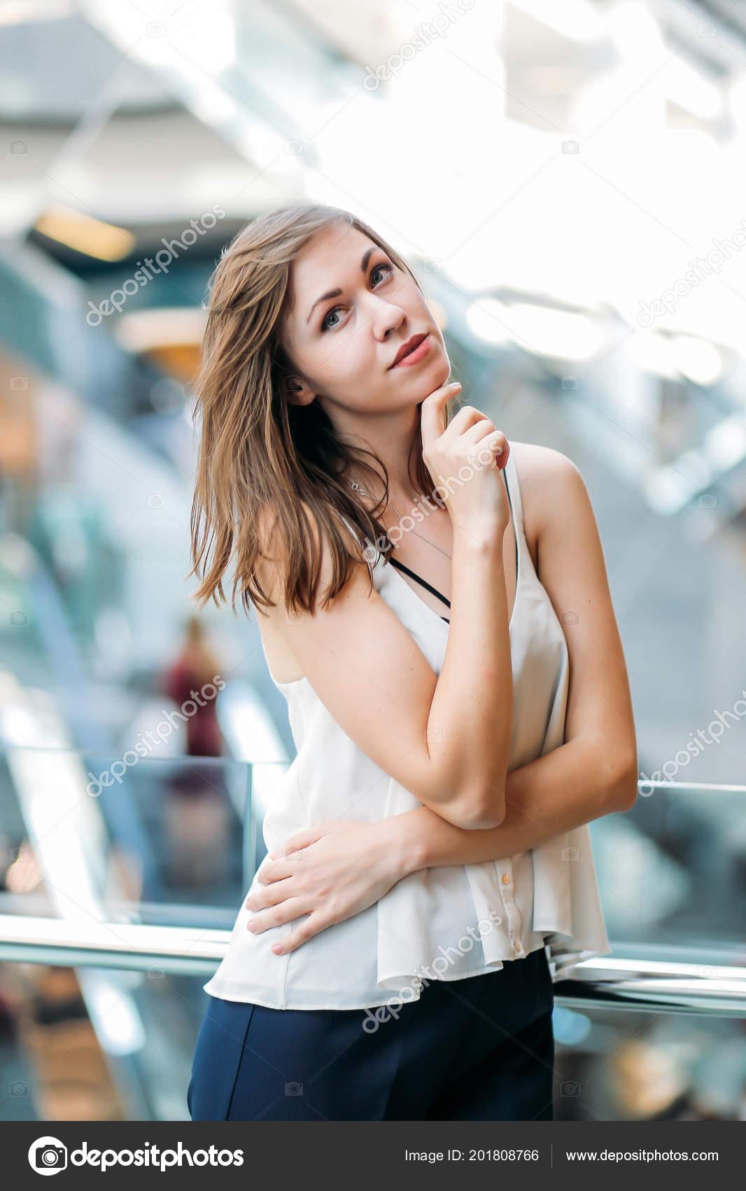 Stylish Model Posing Blurred Shopping Centre Background