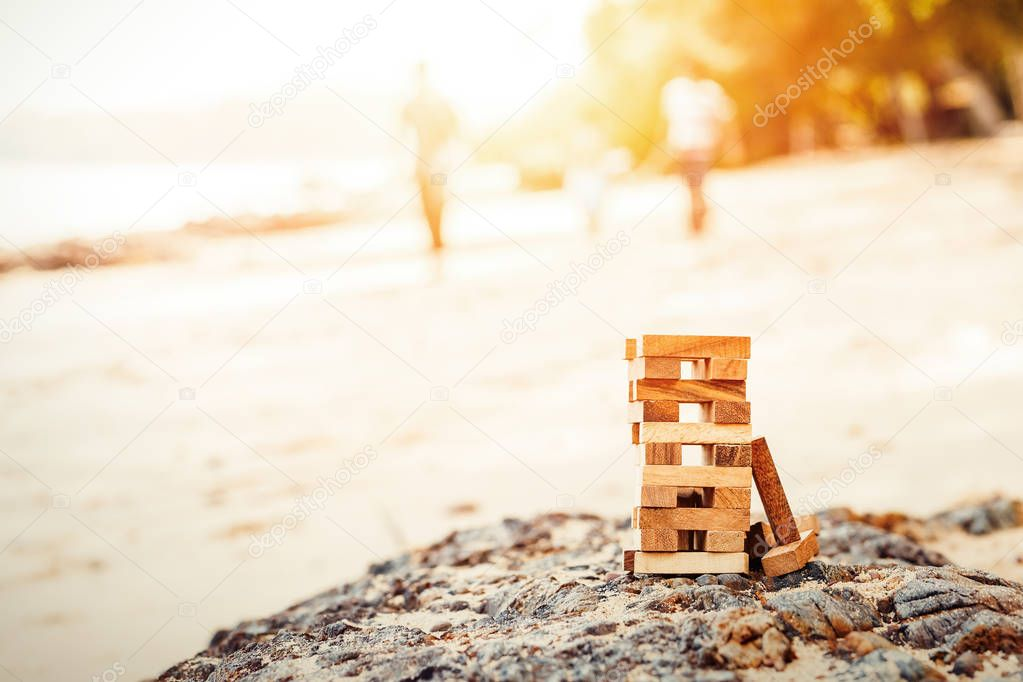 Blocks of wood is On the stone and sand.