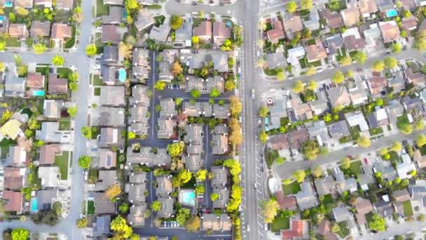 Aerial view of residential houses at spring. American neighborhood, suburb. Real estate, drone shots, sunset, sunlight, from above. backgrond