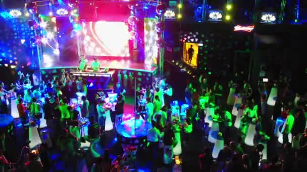 Footage of a crowd or group of young, stylish multi-ethnic people during colorful party in different clothes . Dancers having fun dancing at a party . Shoting drone