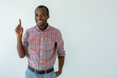 Mind it. Cheerful afro american man making recommendations while standing against white background