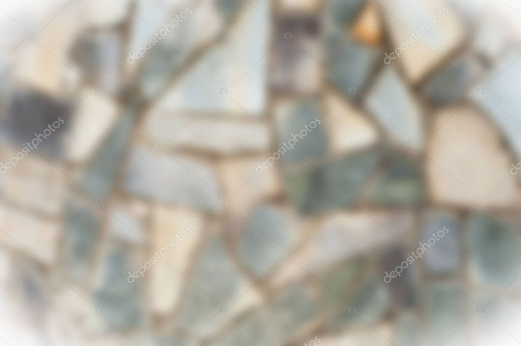 Blurred background. Friendly for designer Texture background image, granite stone is complex in the fence. Stone wall, background with plate. Abstract granite from wall texture