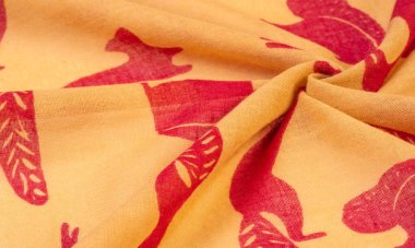 Texture, background, cotton fabric thin yellow with a print of s