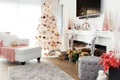 Fotografie White contemporary Christmas tree. A plush loveseat sofa in the foreground with pink accents.