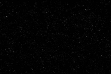 White bokeh on a black background. light spots texture. falling snow. star sky.