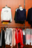 lothing boutique store interior blurred background. Defocused fashion clothing store