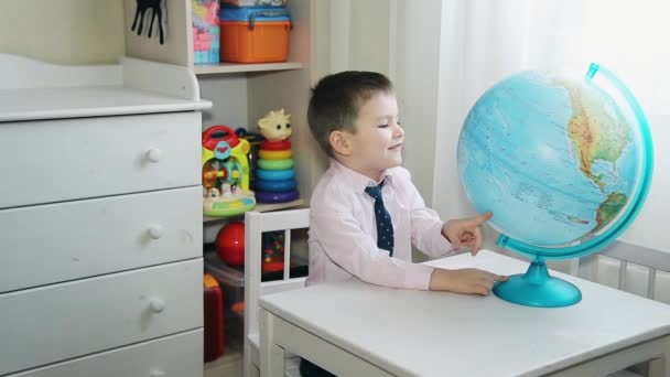 Pre-school child rotates a large globe HD 1920x1080p