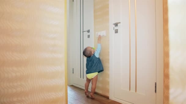 Little girl turns off the bathroom light and the toilet HD 1920x1080p