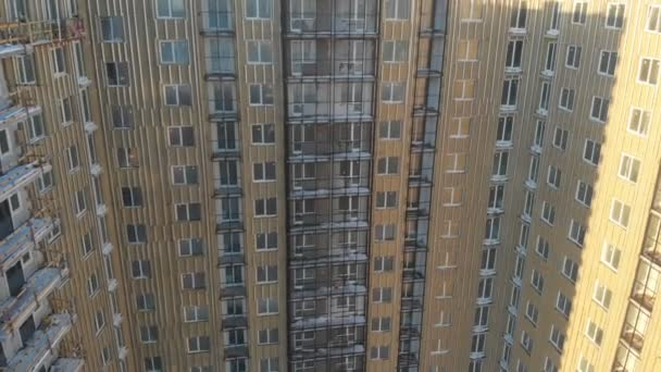 High-rise builders are working on the construction of an apartment building