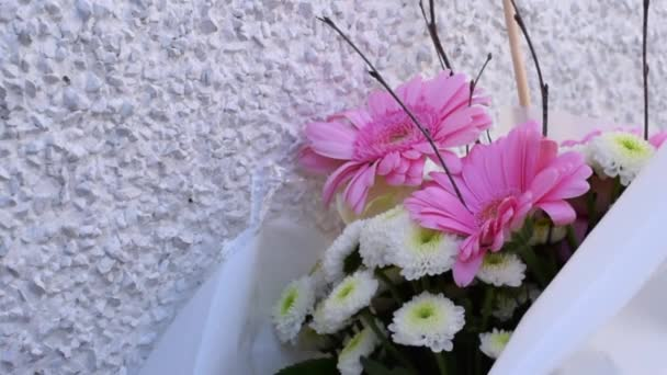 Flower bouquet with pink flowers on white background.