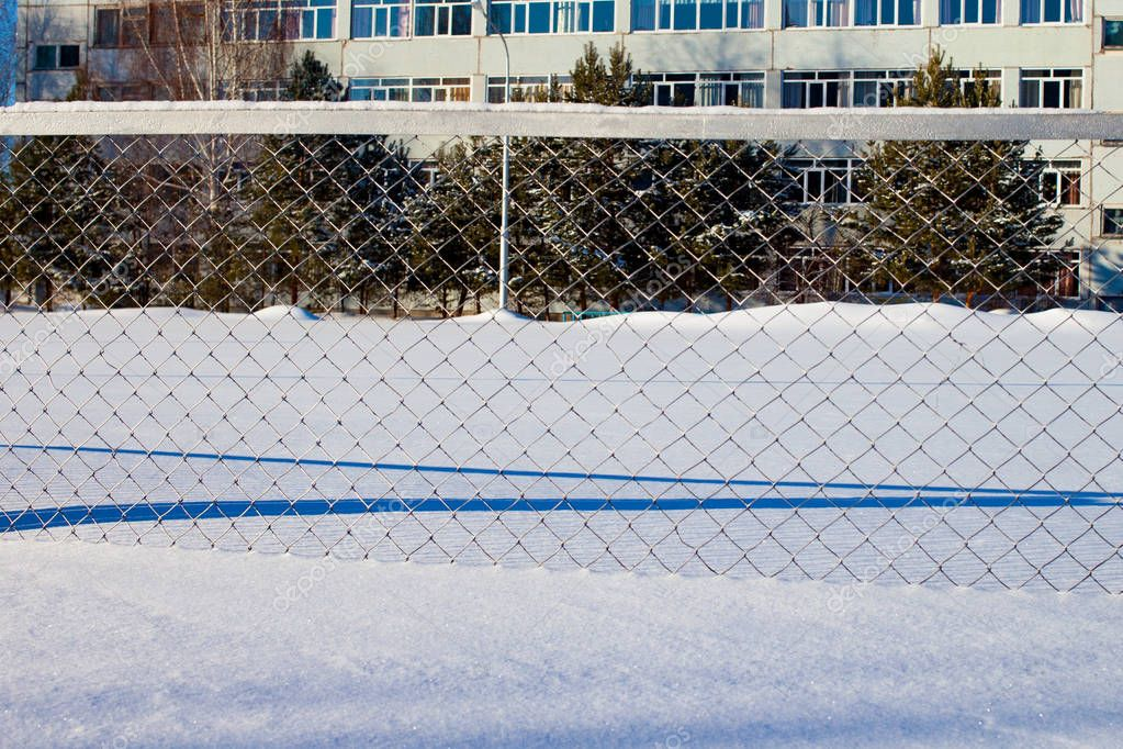 snow-covered metal fence. Winter in Russia.
