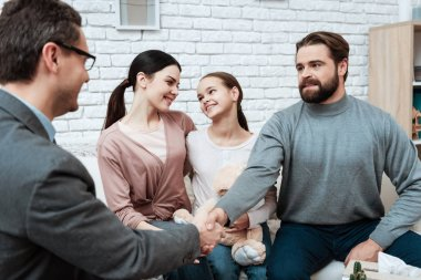 Adult man shaking hands with family psychologist who helped solving problem