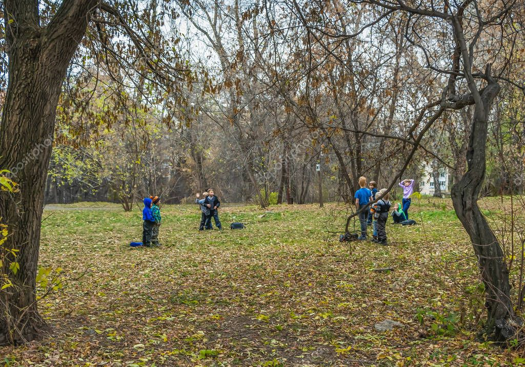 Yekaterinburg, Sverdlovsk Russia - 10 19 2018: The younger school children play in an autumn park