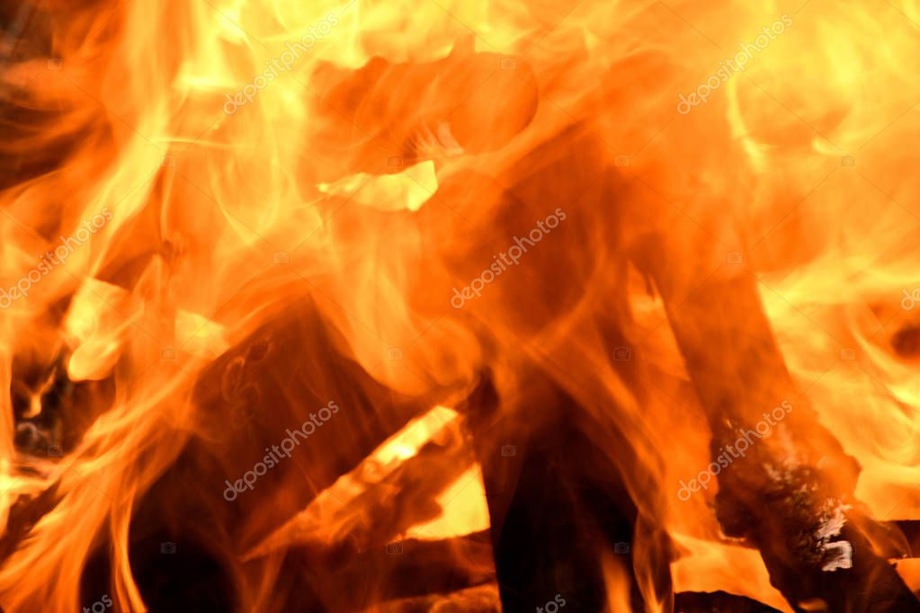 extreme close up of fire and logs in campfire