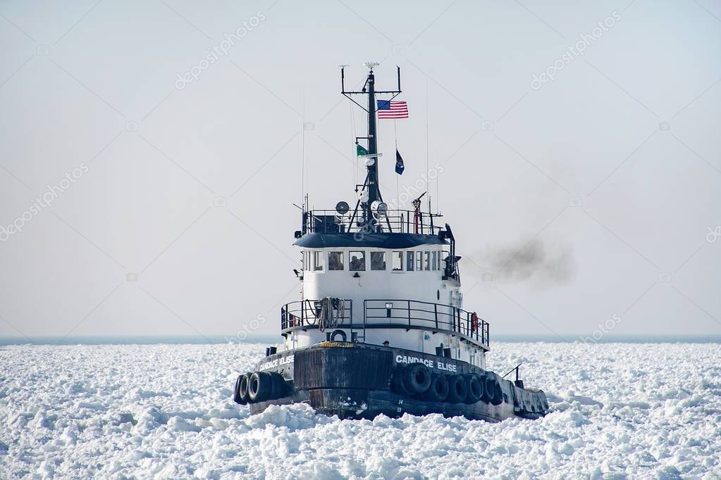 Candace Elise tugboat in frozen Lake Michigan harbor in Holland Michigan