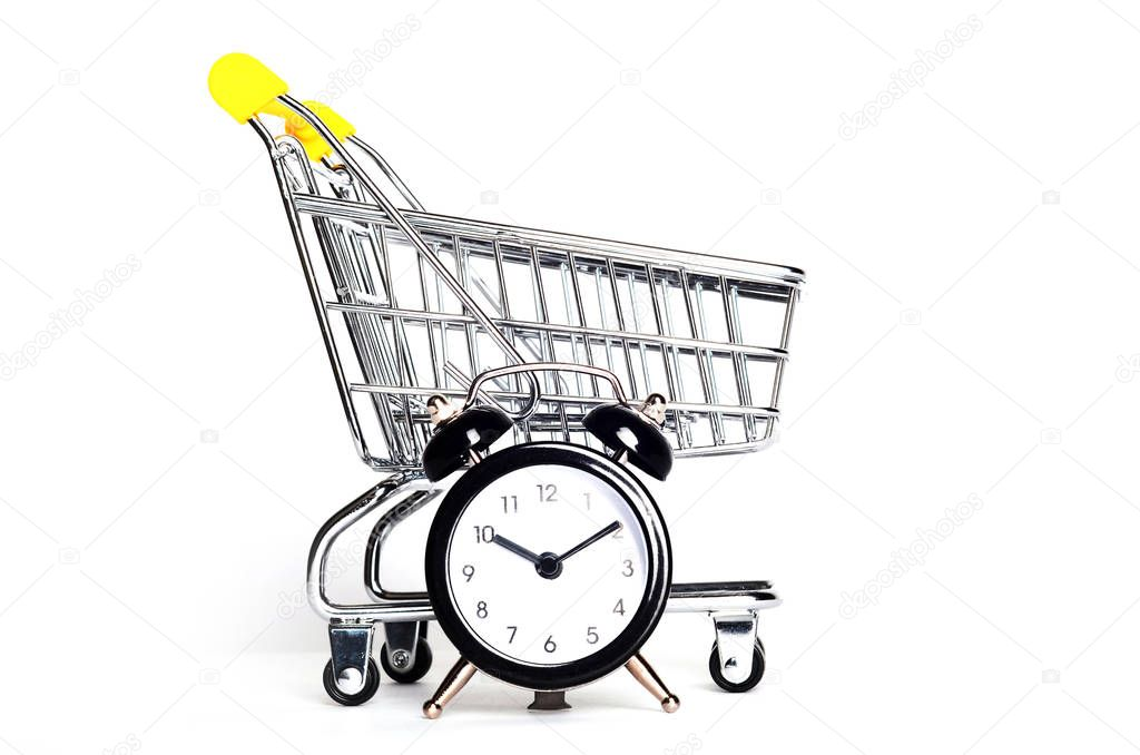 Shopping cart and alarm clock. Time for shopping concept