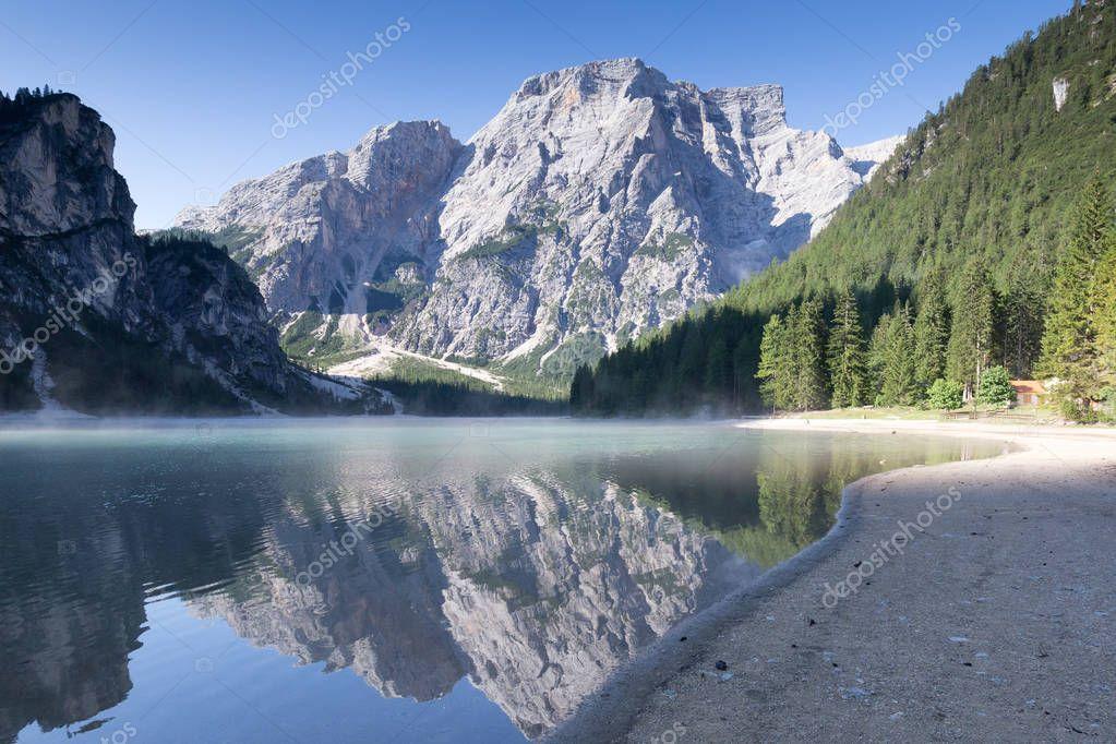 smoking mountain lake with scenic reflection