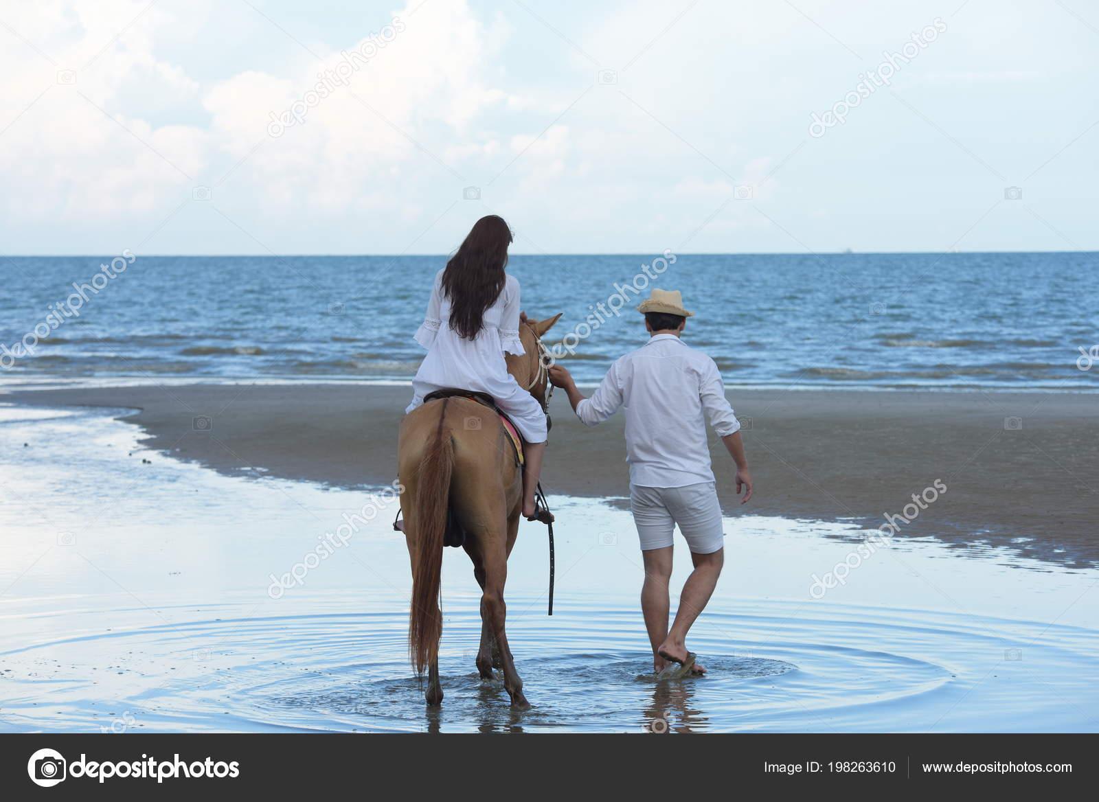 Couples Horses Walking Beach Evening Sunset Stock Photo