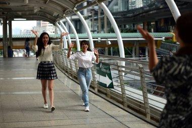 Happy three girls meeting