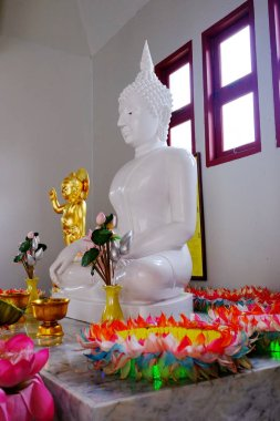 inside of Thai temple with Buddha statue