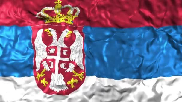 Közelkép a szerb nemzeti zászló integet