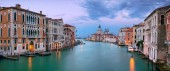 Venice, Italy. Panoramic cityscape image of Grand Canal in Venice, with Santa Maria della Salute Basilica in the background, during sunset