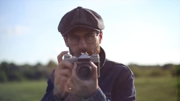 Hipster Photographer Take a Pictures With Vintage Camera In Front Of The Camera Close Up