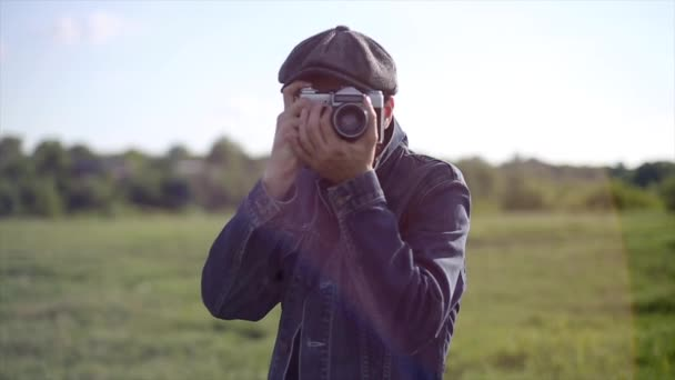 Hipster Photographer Take a Pictures With Vintage Camera In Front Of The Camera