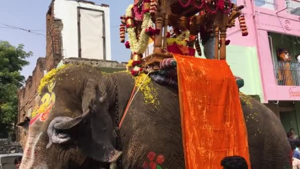 The Dasara festival procession in Towns of India features crowds, dancers and decorated elephants circa in Maski.