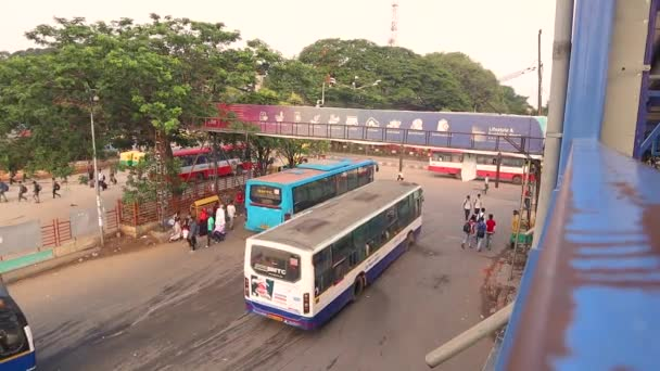Aerial View of urban Public bus station, Buses moving out from the bus station in the majestic bus station Bengaluru, India.