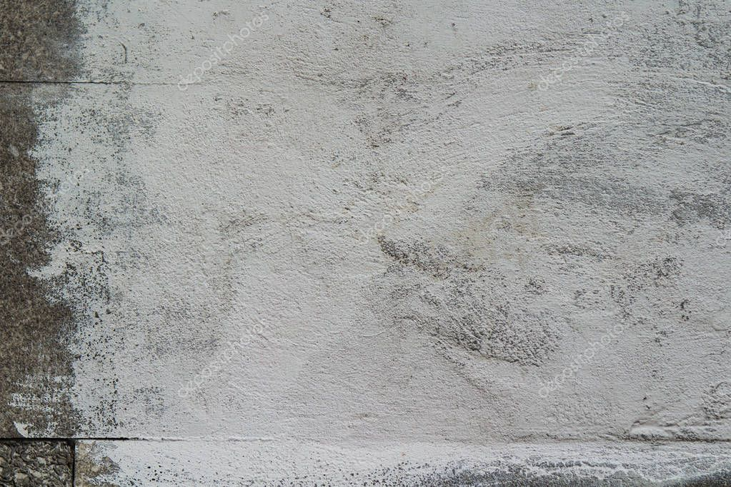 wall with a patch of white paint for the text