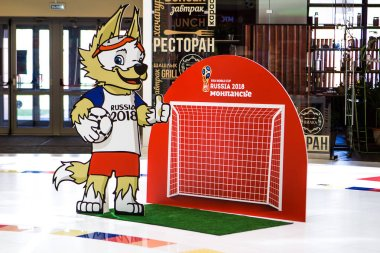 Saint Petersburg, RUSSIA - MAY 28, 2018: Official Wolf Mascot of FIFA 2018 World Cup in Russia - Zabivaka and football gate. Symbol of Football (Soccer) Championship 2018.