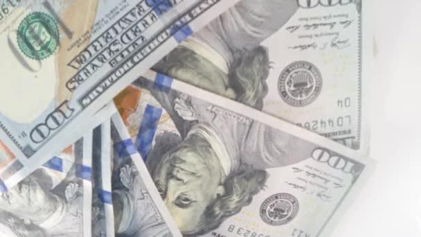 Pénz videofelvétel, forgó pénz video háttér 4k. Dollárt háttér forgó videofelvétel, videoklipek és hírek