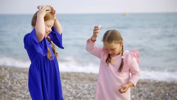 Two beautiful girls being silly outside on the beach.