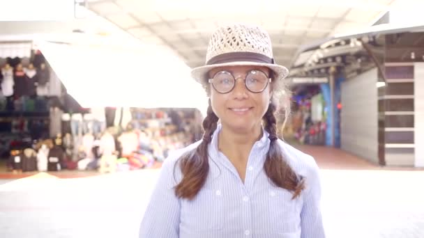 77b5f2236a541 Funny adult woman being funny and childing in goofy round glasses and a hat.–  stock footage
